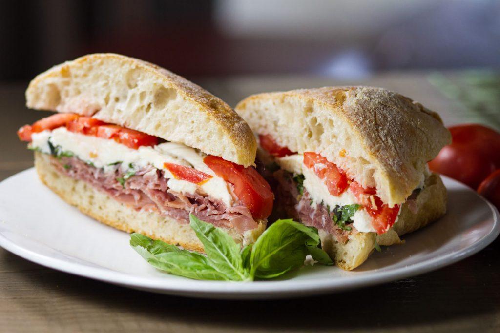 Sazio Sandwich - Prosciutto Di Parma, Fresh Mozzarella, Tomatoes, Basil, Balsamic Vinaigrette on Toasted Ciabatta