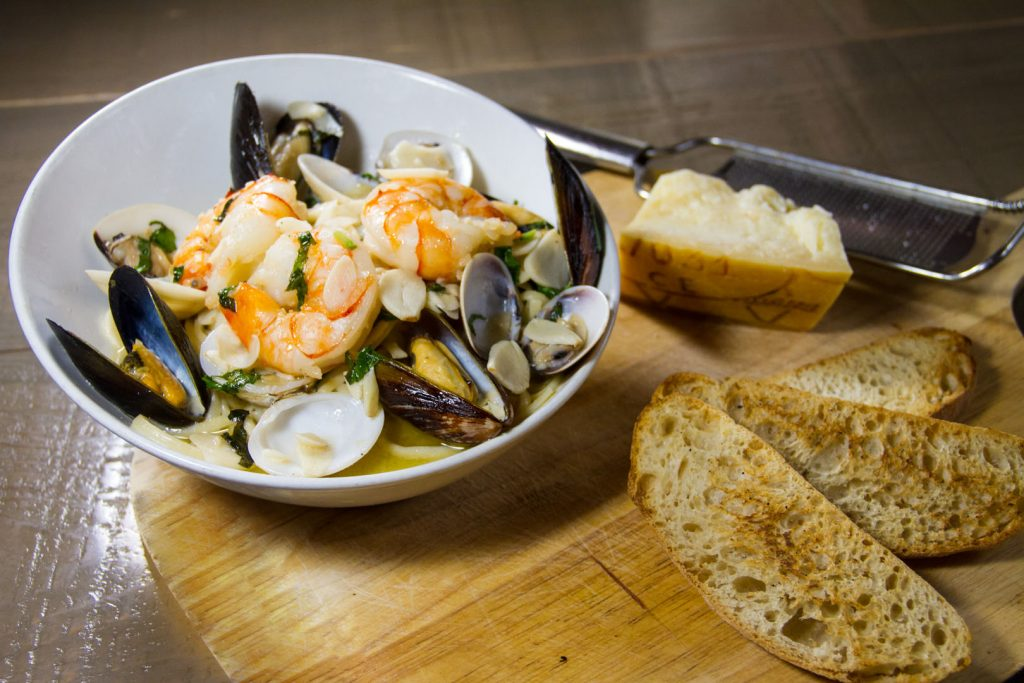 Seafood Pescatore - Sautéed Jumbo Shrimp, Mussels, Clams, White Wine Garlic or Marinara Sauce, over Linguine